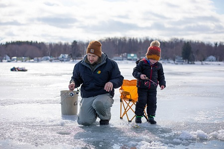 man and child ice fishing