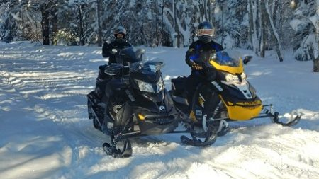 2 people on snowmobiles